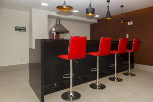 Imagem mostra foto do espaço gourmet do edifício Le Jardin, da Monterre Construtora.
